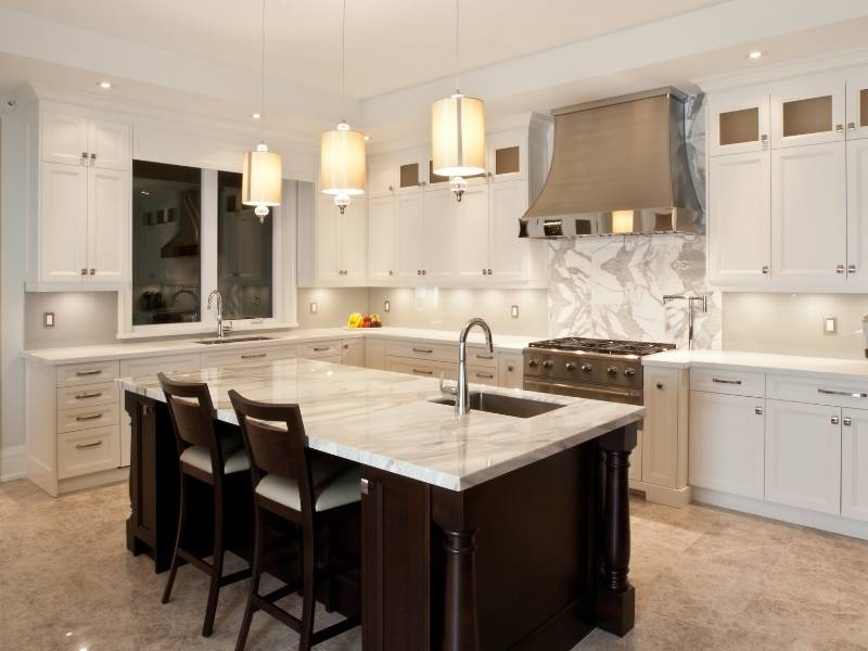 Inspiration for Chandeliers - 3 pendant chandeliers over kitchen island.