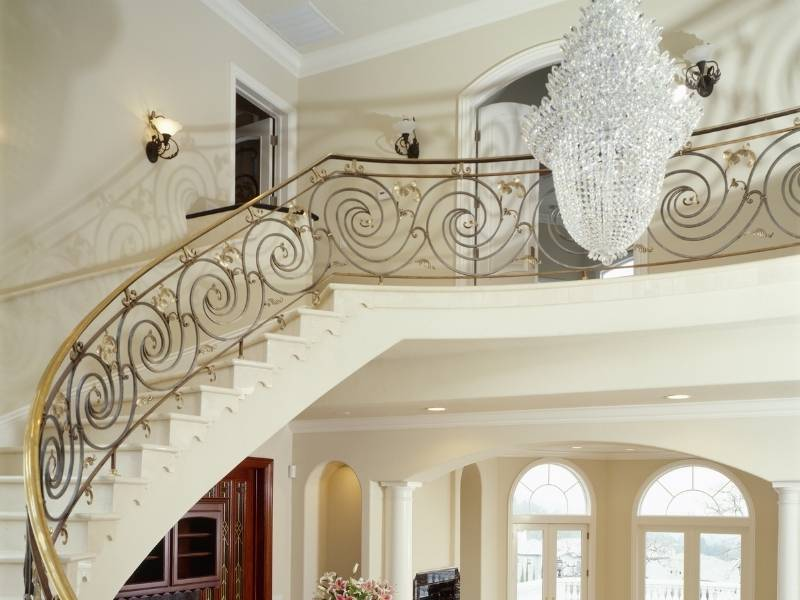 Inspiration for Chandeliers - Gorgeous crystal chandelier hanging over luxury foyer.
