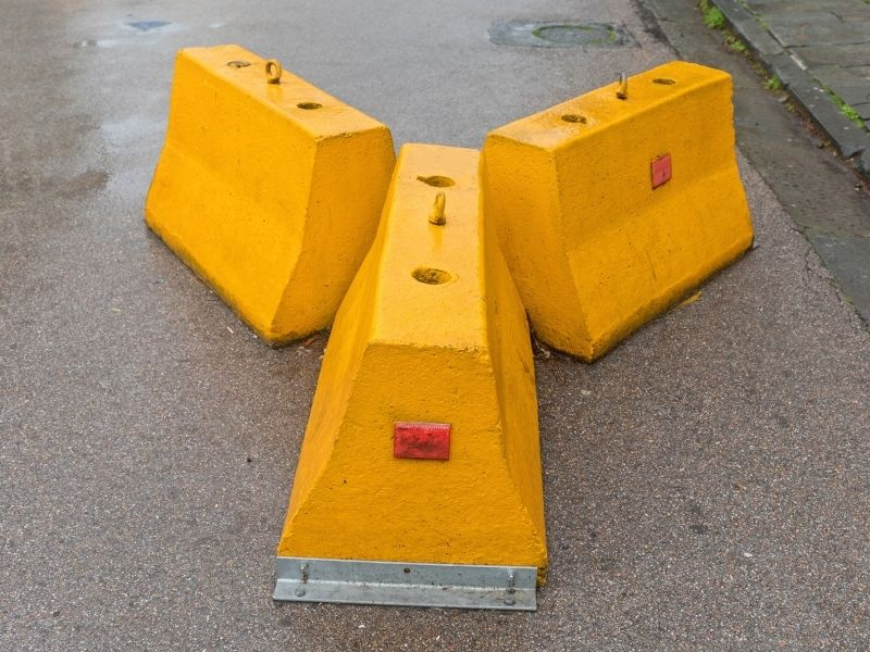 Jersey Concrete Barriers - photo of three jersey concrete barriers in bright yellow.