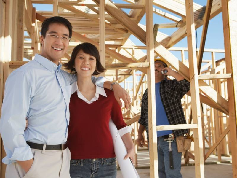 Happy Couple with Home Builder